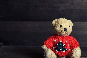 a very old brown teddy bear