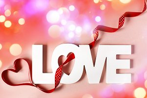 Word Love at pink background