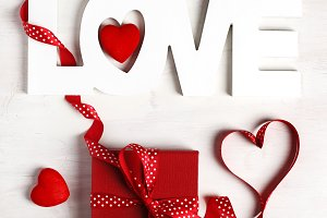 Word Love and red gift box