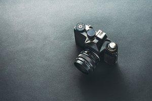 Unrecognizable Old Film Camera On Bl