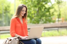 Entrepreneur working with a laptop in a park.jpg