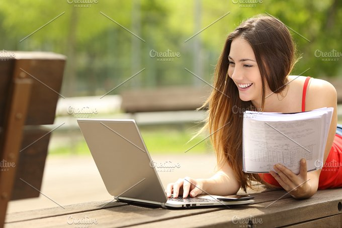 Student learning with a laptop in an university campus.jpg - Technology