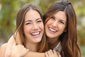 Two women friends laughing with a perfect white teeth.jpg