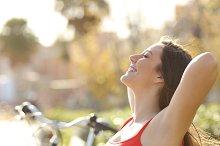 Woman breathing fresh air and relaxing.jpg