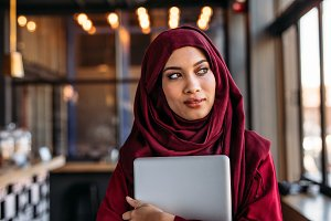 Businesswoman in hijab with laptop