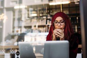 Woman in hijab using laptop
