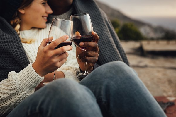 Loving couple with wine on a winter…