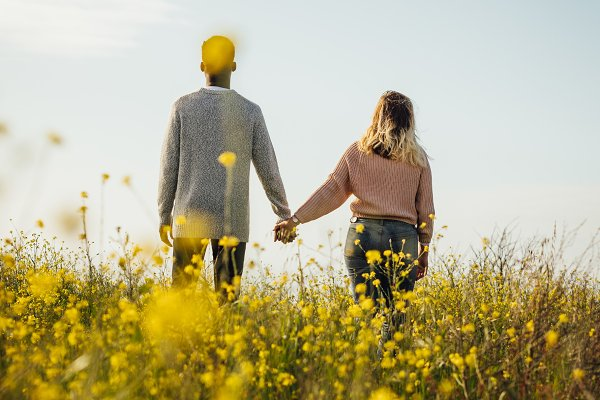 People Images: Jacob Lund - Loving couple in meadow admiring