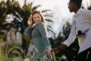 Interracial couple walking