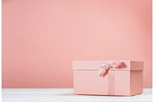 Pink gift box on pink background