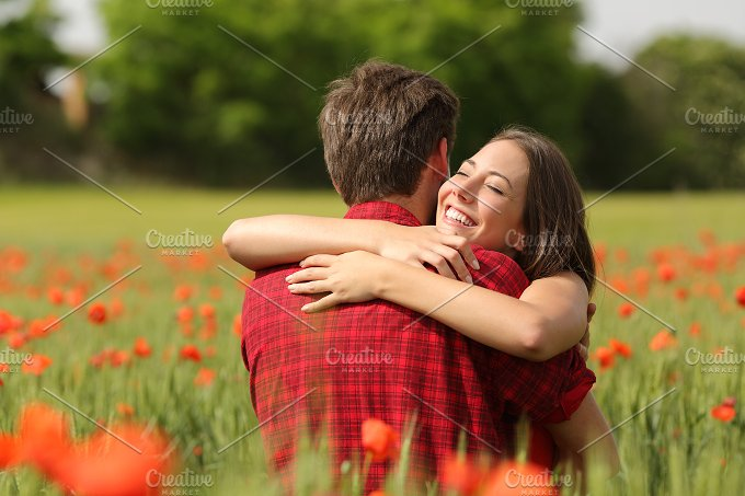 Couple hugging after proposal in a flower field.jpg - People