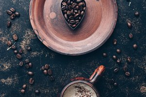 Heart of coffee beans and hot coffee
