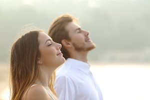 Couple of man and woman breathing deep fresh air.jpg