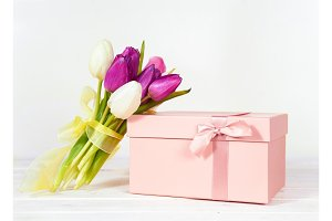 Pink gift box with purple tulips