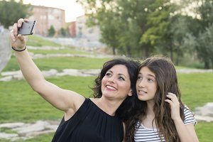 Mother and daughter makes a selfie