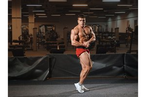 Young man bodybuilder standing in