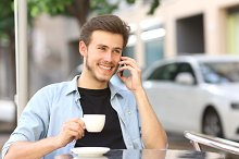 Man talking on the mobile phone in a coffee shop.jpg