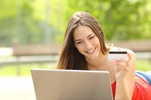 Shopper girl buying online with a laptop and credit card.jpg