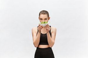 healthy fitness woman eating salad