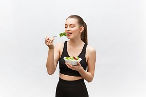 Young beautiful sport woman eating