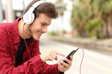 Teenager student learning with online course in a smart phone.jpg