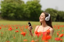 Woman breathing and listening music in a field.jpg