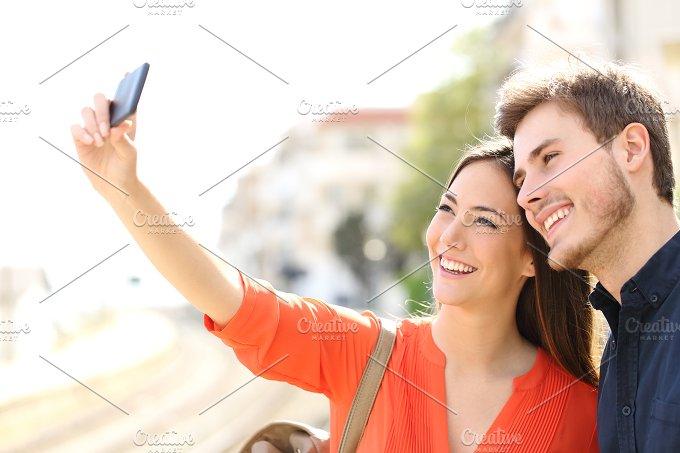 Traveler tourists couple photographing a selfie.jpg - Technology