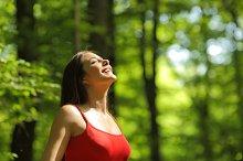 Woman breathing fresh air in the forest.jpg