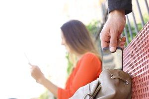 Thief stealing a mobile phone.jpg