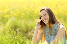Woman calling on the mobile phone in a green field.jpg