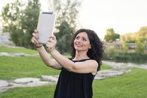 Women make selfie with the tablet