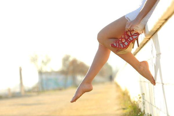 Woman legs silhouette with heels ha…