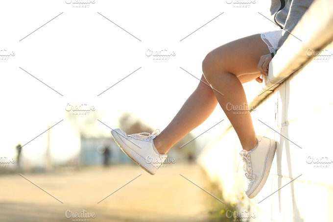 Urban teenager legs wearing sneakers.jpg - Sports