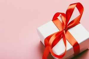 White gift box with a red ribbon