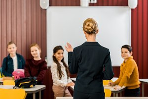 back view of teacher talking with sm