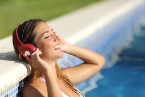 Relaxed woman listening to the music with headphones.jpg