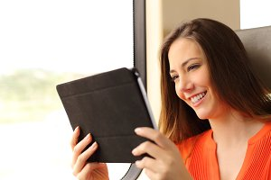 Passenger woman reading a tablet or ebook in a train.jpg