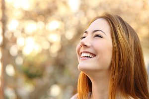 Portrait of a woman laughing with a perfect teeth.jpg