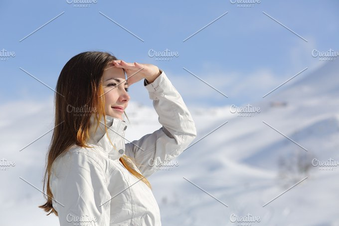 Hiker woman looking forward in the snowy mountain.jpg - People