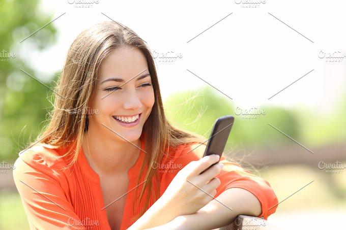 Girl using a smart phone in summer.jpg - Technology