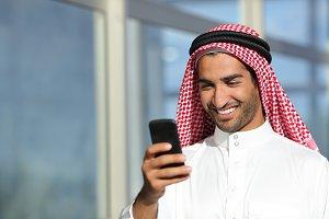 Arab saudi businessman working  with his phone.jpg