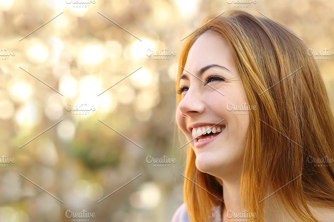Facial portrait of a funny woman face laughing.jpg - People