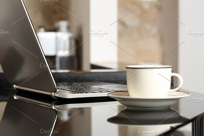 Laptop on a table with a cup of coffee.jpg - Technology