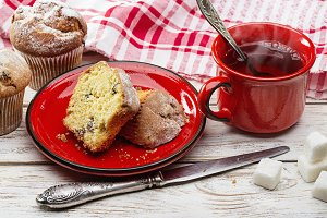 Fresh muffins and hot tea in red cup