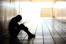 Teenager depressed sitting inside a dirty tunnel.jpg