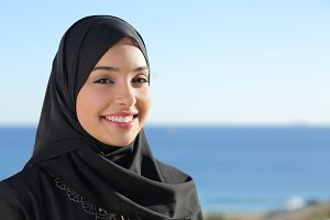 Beautiful arab saudi woman face posing on the beach.jpg