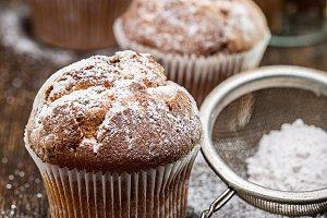 Fresh muffins with powdered sugar.