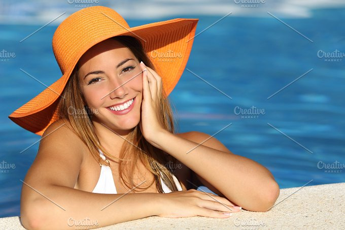 Girl on holidays with a perfect white smile.jpg - Holidays