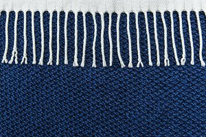 Blue knitted background with white