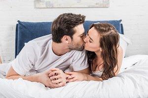 beautiful couple in nightwear kissin